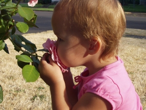 Child stopping to smell the roses