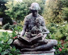 Statue of mother reading to child