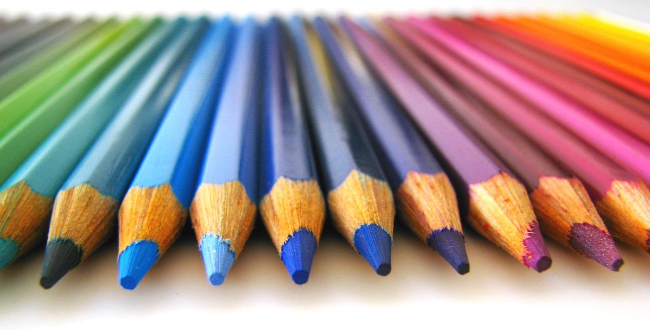 Colored pencils arranged like a rainbow